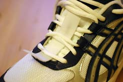 Shoes with iStrap fitted under the laces