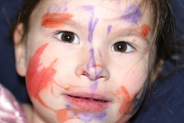 Natalie paints her face
